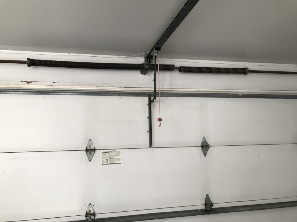 What to do if the Torsion Spring Fails | Garage Door Broken Spring | Star Solutions Garage Door